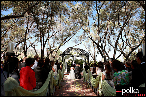 The ceremony location resembles an enchanted forest wedding ceremony